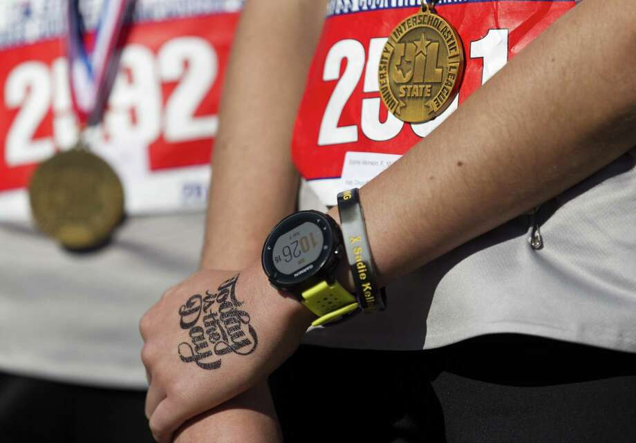 "The left hand of Sophie Atkinson of Cinco Ranch is seen stamped with the words ""Today is the Day"" after she finished ninth overall in the Class 6A girls race during the UIL State Cross Country Championships, Saturday, Nov. 3, 2018, in Round Rock. Photo: Jason Fochtman, Houston Chronicle / Staff Photographer / © 2018 Houston Chronicle"