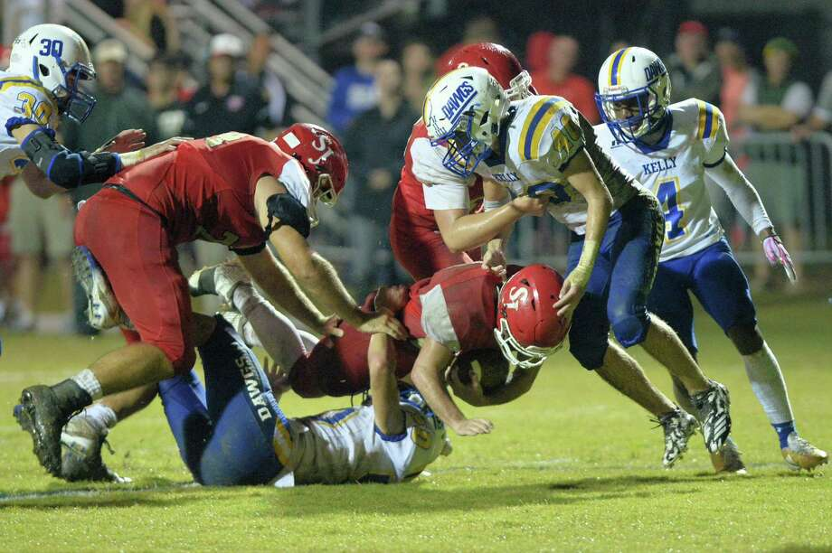 Tommy Loyd (C) (22) of St. John XXIII dives for a first down in the second quarter of a high school football game between the St. John XXIII Lions and the Beaumont Kelly Bulldogs on Friday, Oct. 19, 2018, at St. John XXIII in Katy. Photo: Craig Moseley, Houston Chronicle / Staff Photographer / ©2018 Houston Chronicle