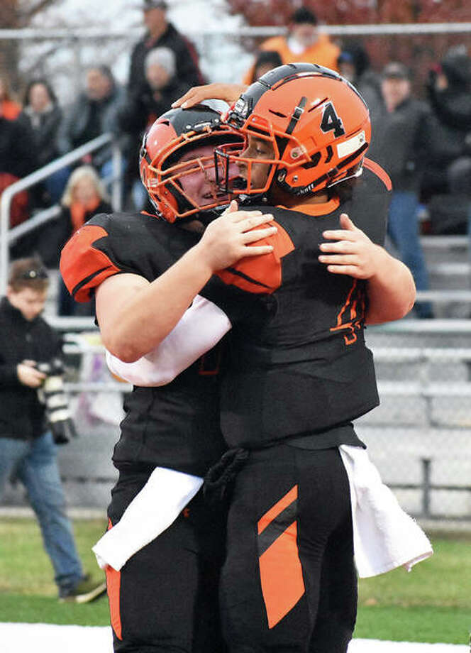 Edwardsville center Blake Moss, left, congratulates quarterback Kendall Abdur-Rahman after a touchdown in the second quarter against West Aurora on Saturday at the District 7 Sports Complex. Photo: Matt Kamp | For The Telegraph