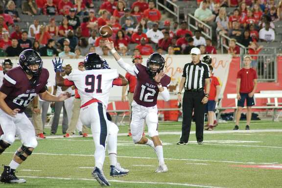 Pearland's J.D. Head fires a pass against Dawson earlier this season at the University of Houston.