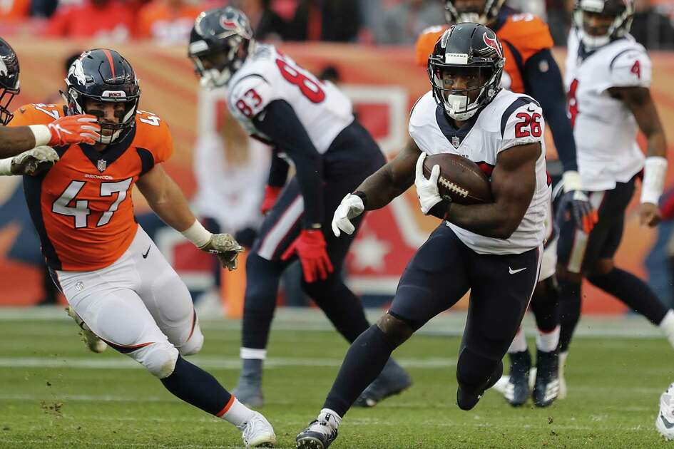 Texans running back Lamar Miller, right, runs past Broncos linebacker Josey Jewell during Sunday' victory in Denver.