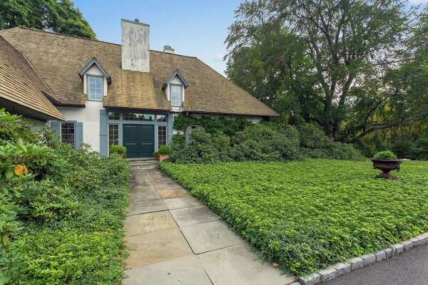 A French country cottage was built in 1980 on a portion of property originally part of the Bedford Gardens and Estate at 77 Beachside Avenue in Greens Farms.