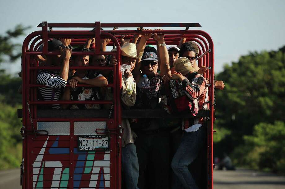 Members of the Central American caravan head out at dawn for their next destination on Thursday in Juchitan de Zaragoza, Mexico. President Trump has responded by sending troops to the border. Photo: Spencer Platt /Getty Images / 2018 Getty Images