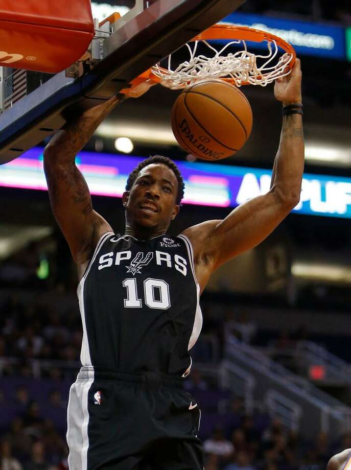 San Antonio Spurs guard DeMar DeRozan dunks against the Phoenix Suns in the first half during an NBA basketball game, Wednesday in Phoenix. Photo: AP Photo /Rick Scuteri