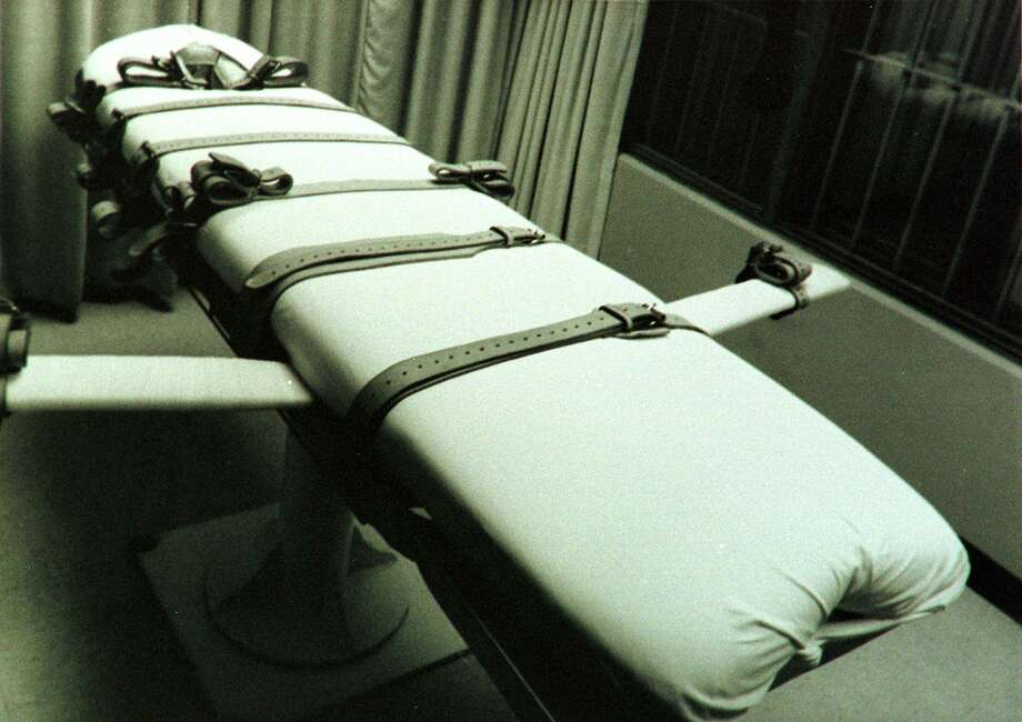 In this file photo released February 2, 1998 by the Texas Department of Corrections, shows the gurney used to execute prisoners by lethal injection in the Huntsville Unit in Huntsville, Texas. capital cases in Texas cost about $2.5 million each. Photo: HO /AFP /Getty Images / AFP