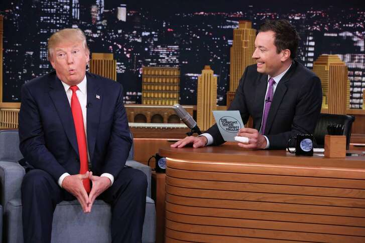 """In this image released by NBC, Republican presidential candidate Donald Trump, left, appears with host Jimmy Fallon during a taping of """"The Tonight Show Starring Jimmy Fallon,"""" in 2015."""