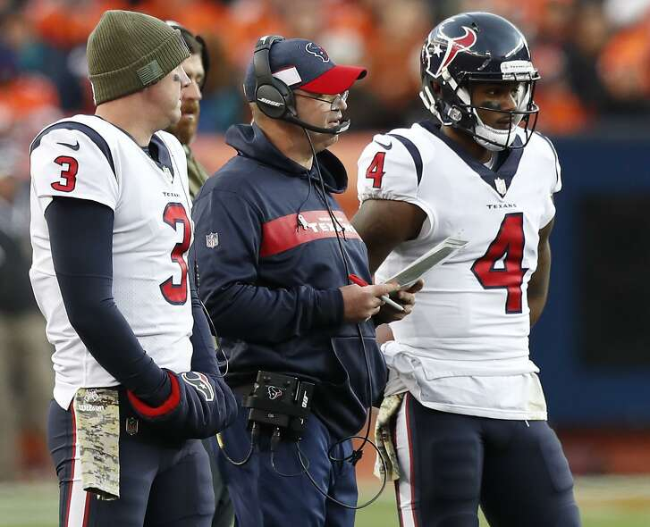 Houston Texans head coach Bill O'Brien stands with quarterbacks Brandon Weeden (3) and Deshaun Watson (4) during a time out during the third quarter of an NFL football game against the Denver Broncos at Broncos Stadium at Mile High on Sunday, Nov. 4, 2018, in Denver.