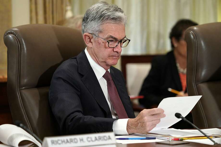Fed Chairman Jerome Powell looks over papers during a Federal Reserve Board meets last week. Photo: Jacquelyn Martin / Associated Press