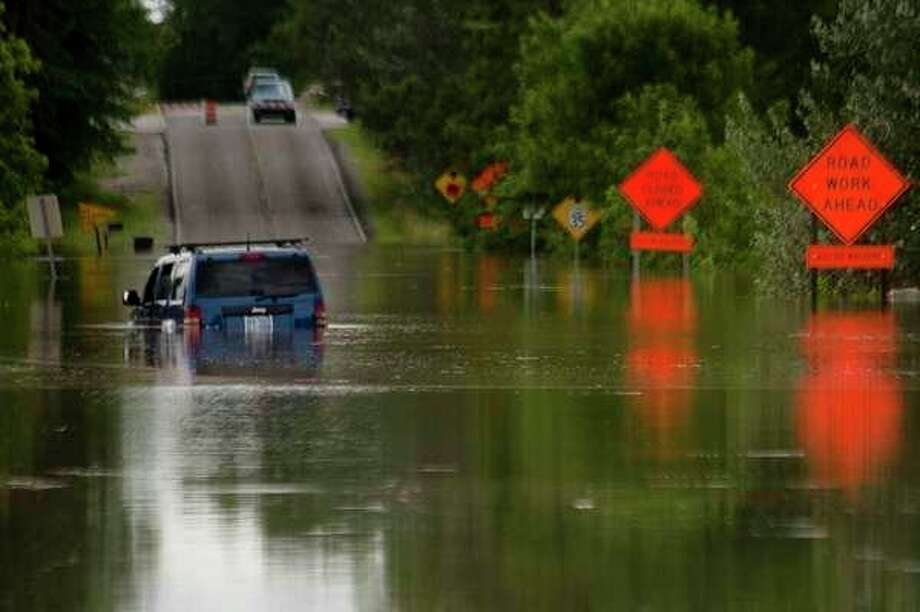 A vehicle is partially submerged in floodwater on North Sturgeon Road north of Airport Road on Friday, June 23, 2017.
