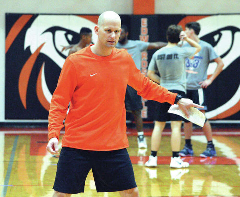 Edwardsville boys' basketball coach Dustin Battas gives instructions on Monday during the Tigers' first practice at Lucco-Jackson Gymnasium. Battas takes over for Mike Waldo, who was head coach for 30 seasons.