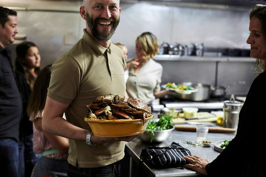 Rupert Blease is anything but crabby with a bowl of Dungeness. Photo: John Lee / Special To The Chronicle
