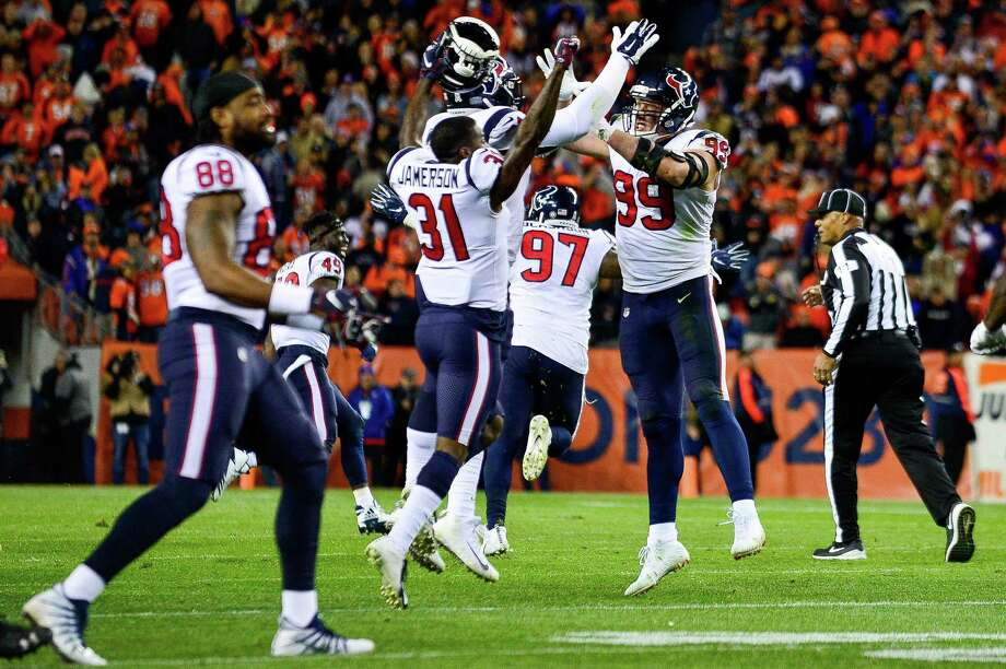 Defensive end J.J. Watt #99 of the Houston Texans celebrates with teammates after a missed field goal by the Denver Broncos led to a 19-17 win at Broncos Stadium at Mile High on November 4, 2018 in Denver, Colorado. Photo: Dustin Bradford, Stringer / Getty Images / 2018 Getty Images