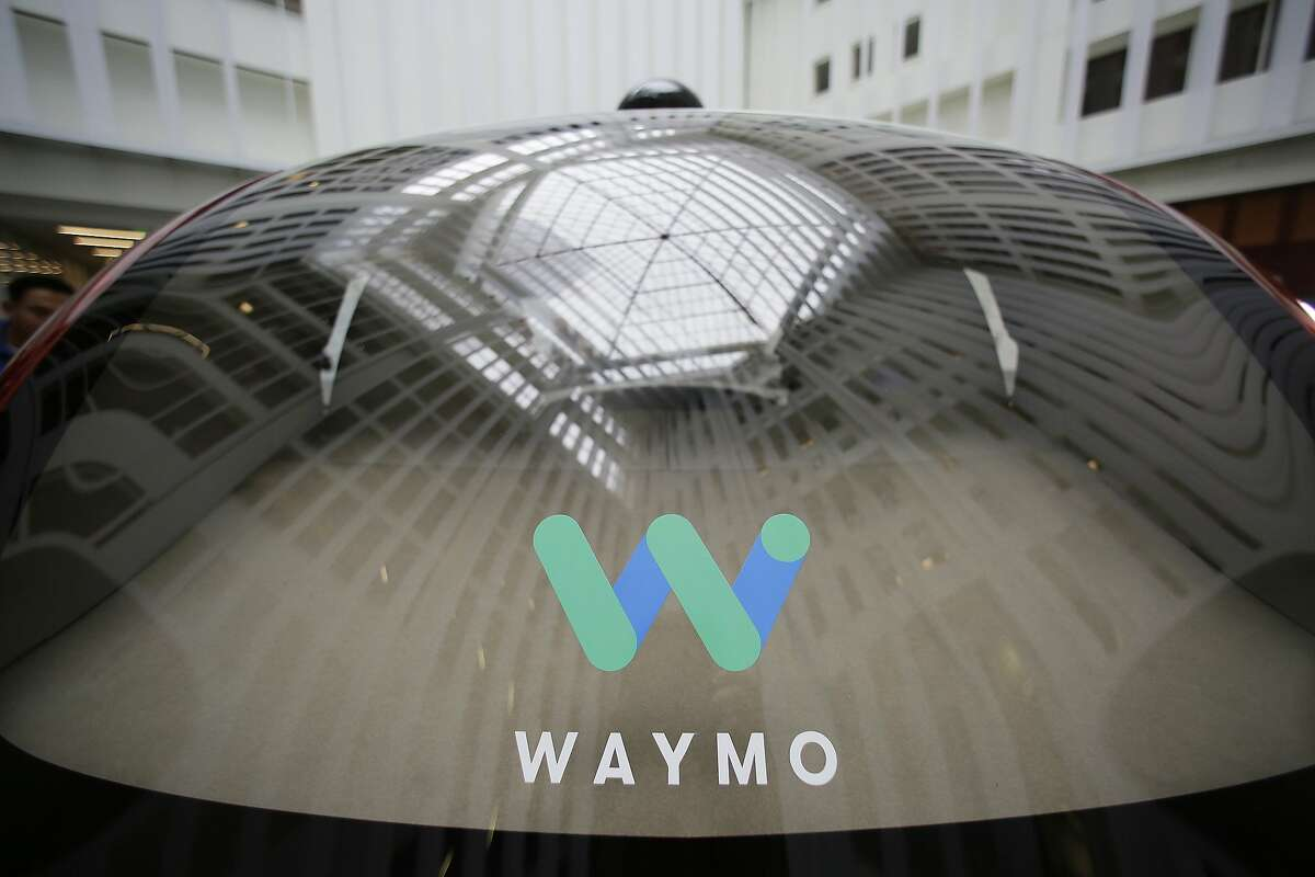 FILE - In this Dec. 13, 2016, file photo, a skylight is reflected in the rear window of a Waymo driverless car during a Google event in San Francisco. Google's robotic car spin-off Waymo is poised to become the first to test fully driverless vehicles on California's public roads. (AP Photo/Eric Risberg, File)