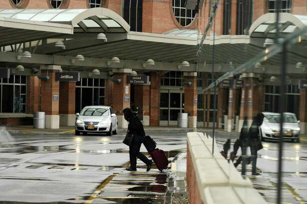 Passengers arrive at Albany International Airport on Monday, Nov. 5, 2018, in Colonie, N.Y. Ride-sharing company Uber has begun operations at Albany International Airport. (Will Waldron/Times Union)