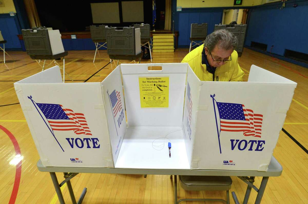 Residents head to the polls to vote on election day, Tuesday, Nov. 7, 2017 in Norwalk Conn.