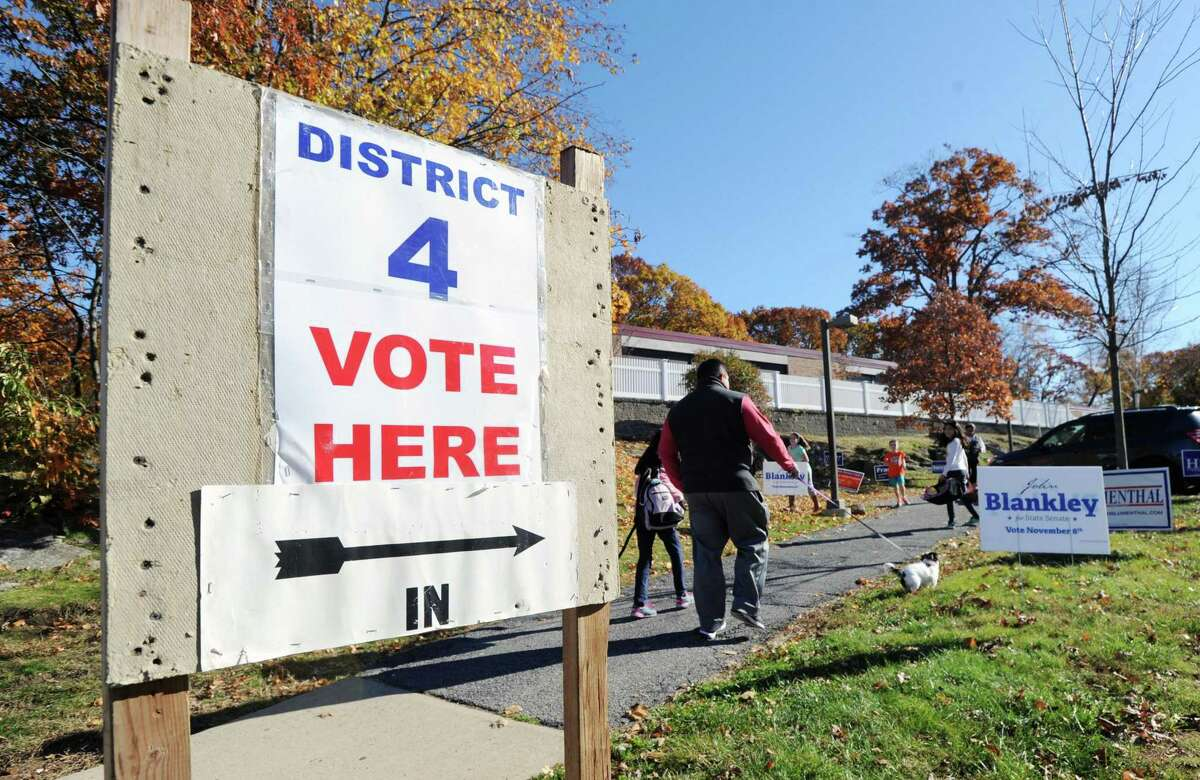"""""""District 4 Vote here,"""" reads the sign in front of New Lebanon School on election day in the Byram section of Greenwich on Election Day in 2016."""