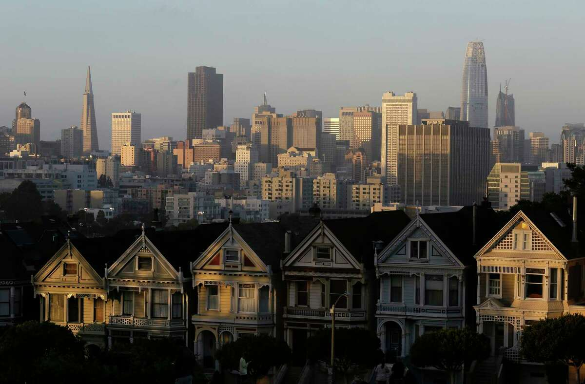 FILE - This July 11, 2017, file photo, shows the skyline beyond a row of Victorian houses in San Francisco.