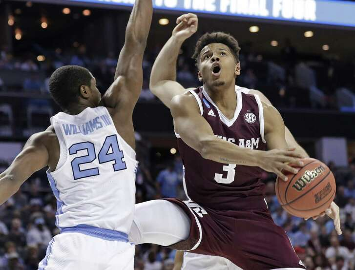 FILE - In this March 18, 2018, file photo, Texas A&M's Admon Gilder (3) drives against North Carolina's Kenny Williams (24) during the first half of a second-round game in the NCAA men's college basketball tournament in Charlotte, N.C. The Aggies guards will be led by senior Admon Gilder, who was second on the team with 12.3 points last year despite missing time with a knee injury. (AP Photo/Gerry Broome, File)