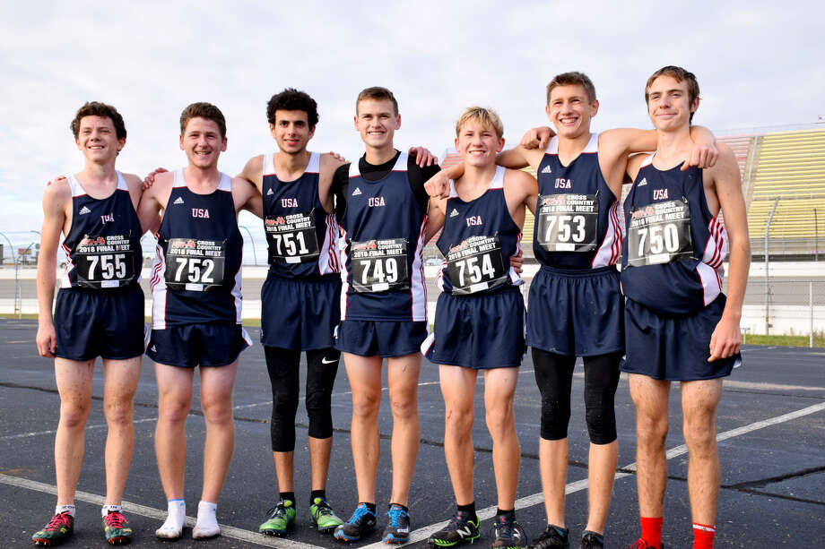 From left, USA teammates Jacob Vanhove, Nicholas Kilburn, David Khoury, Bentley Alderson, Ty Pavlickek, Bryce Langmaid and Tyler Aleksink pose after finishing fifth in the Division 4 state finals, Saturday, at Michigan International Speedway. (Submitted Photo)