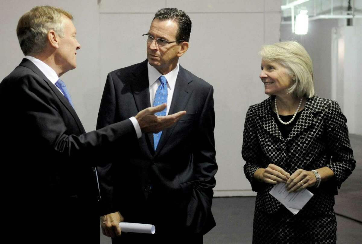 Charter Communications First Five packages $8.5 million in 2014; $20 million pending in 2018 - From left, Charter CEO Tom Rutledge, Governor Dannel Malloy, and Catherine Smith, Commissioner of the Department of Economic and Community Development, speak before a press conference on Tuesday, October 2, 2012, at 400 Atlantic Street in Stamford to announce Charter Communications will be coming to the town.