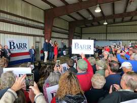 Donald Trump Jr., center, and former Fox News host Kimberly Guilfoyle, right, urge a crowd of supporters to vote for U.S. Rep. Andy Barr, left, at a rally on Monday, Nov. 5, 2018, in Mount Sterling, Ky. Barr is in a tight race for in Kentucky's 6th Congressional district against Democrat Amy McGrath.