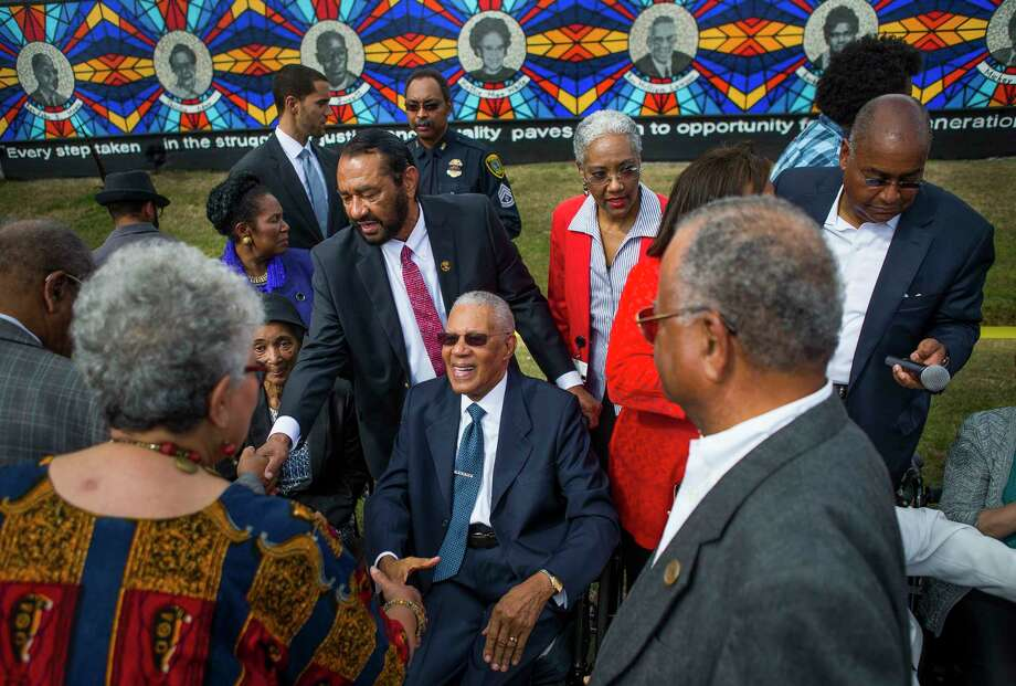 People greet the Rev. William Lawson during the dedication of The Sacred Struggles / Vibrant Justice Mural along the Columbia Tap trail behind the Pilgrim Congregational United Church of Christ, Monday, Nov. 5, 2018 in Houston. The mural pays tribute to eight of Houston's African American civil rights leaders. Photo: Mark Mulligan, Staff Photographer / © 2018 Mark Mulligan / Houston Chronicle