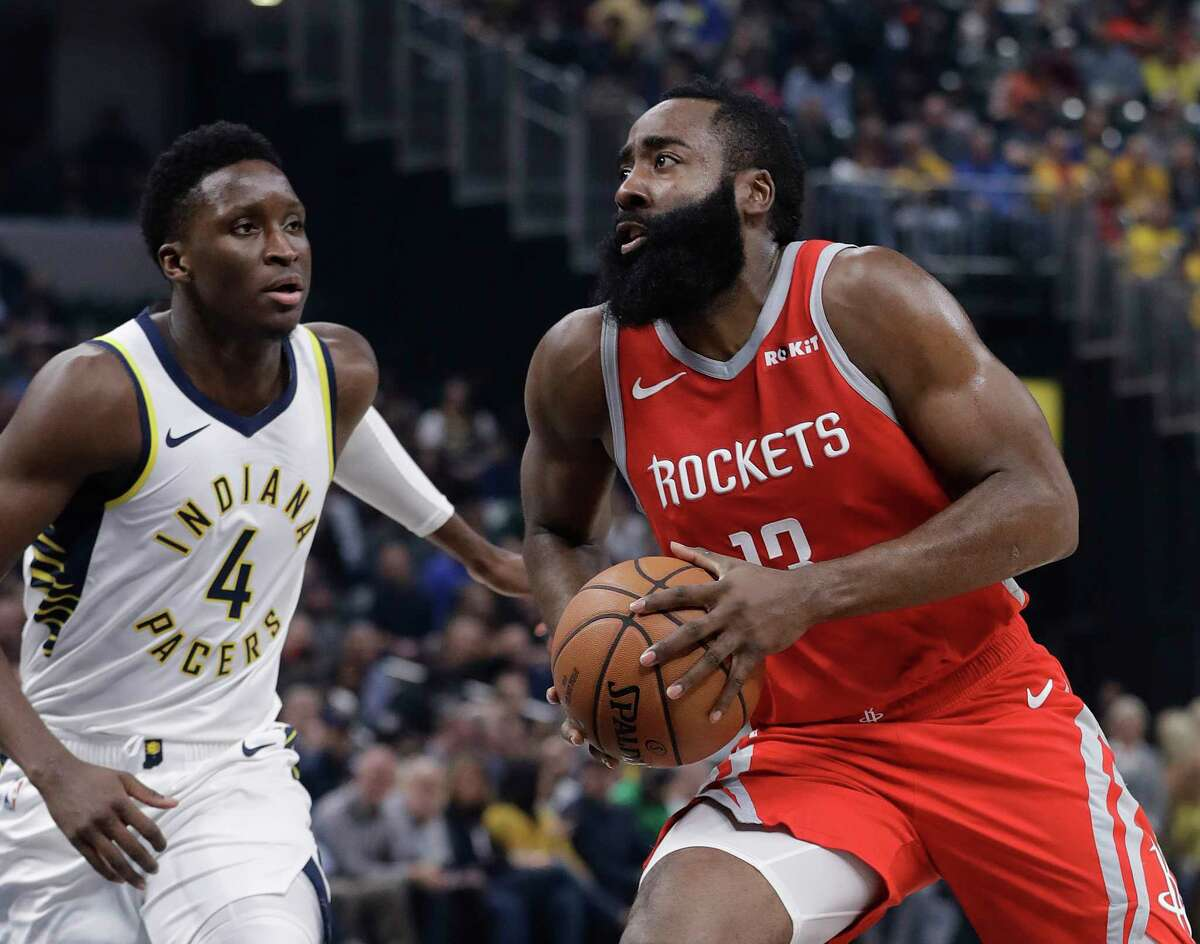 Houston Rockets' James Harden goes to the basket against Indiana Pacers' Victor Oladipo during the first half of an NBA basketball game, Monday, Nov. 5, 2018, in Indianapolis. (AP Photo/Darron Cummings)