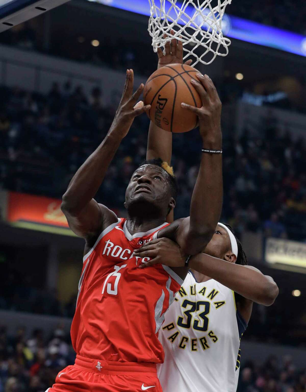 Houston Rockets' Clint Capela (15) shoots against Indiana Pacers' Myles Turner during the first half of an NBA basketball game, Monday, Nov. 5, 2018, in Indianapolis. (AP Photo/Darron Cummings)