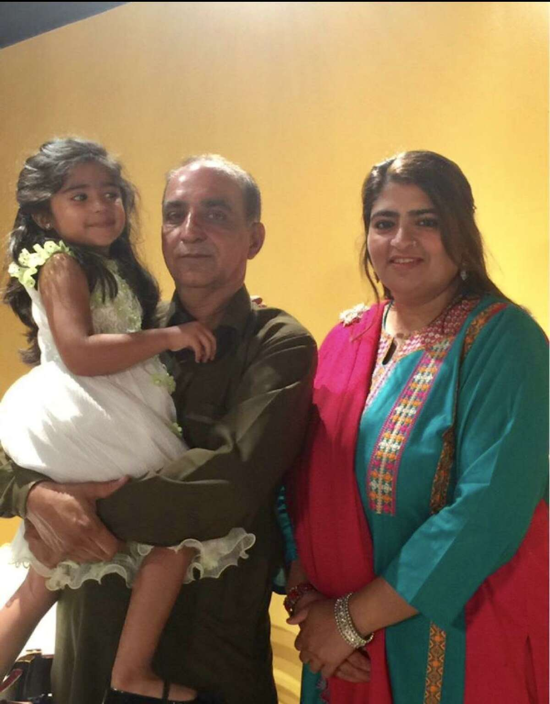 Malik Naveed bin Rehman, left, and his wife, Zahide Altaf, with their daughter, Roniya
