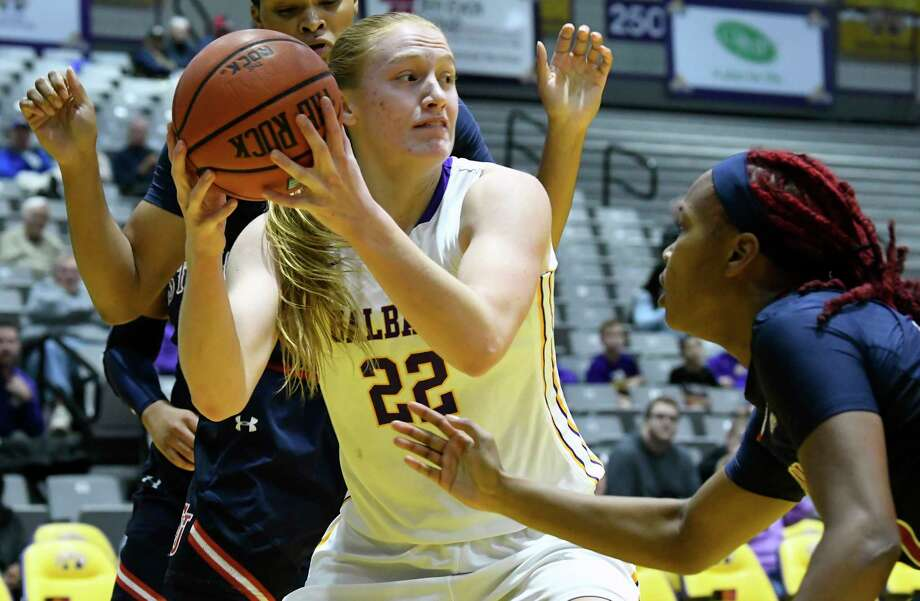 UAlbany's forward Heather Forster (22) moves the ball against St. John's player during the second half of an NCAA college basketball game on Thursday, Nov. 30, 2017, in Albany, N.Y. St. John won the game71-66.(Hans Pennink / Special to the Times Union) ORG XMIT: HP101 Photo: Hans Pennink / 20042275A