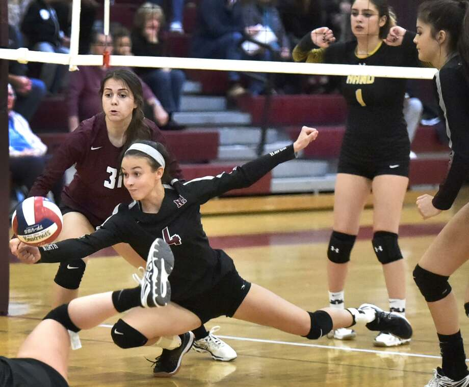 North Haven's Gisele Zumerchik hits the floor as she hustles to the ball against Hand on Monday night. Photo: Peter Hvizdak / Hearst Connecticut Media / New Haven Register