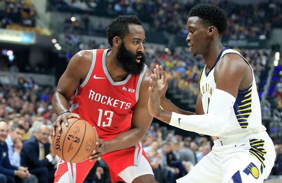 James Harden (13) of the Houston Rockets is defended by Victor Oladipo (4) of the Indiana Pacers at Bankers Life Fieldhouse on November 5, 2018 in Indianapolis, Indiana. Photo: Andy Lyons, Staff / Getty Images / 2018 Getty Images