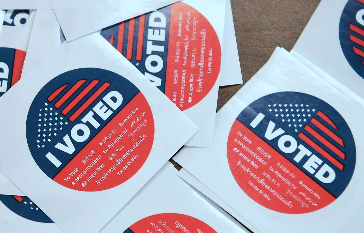 """California's multi-language """"I Voted"""" stickers on offer for early voters at the Los Angeles County Registrar's Office in Norwalk, California on November 5, 2018, a day ahead the November 6 midterm elections in the United States. (Photo by Frederic J. BROWN / AFP)FREDERIC J. BROWN/AFP/Getty Images"""