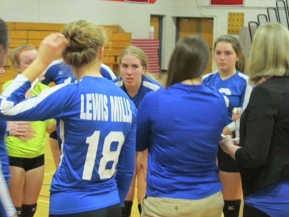 Lewis Mills star Anna Szymanski, center, led the Spartans to a Class M girls volleyball first round win at Northwestern High School Monday night. Photo: Peter Wallace / For Hearst Connecticut Media