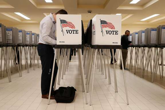 Voters cast their ballots during early voting at City Hall in San Francisco, Calif. on Monday, Nov. 5, 2018.