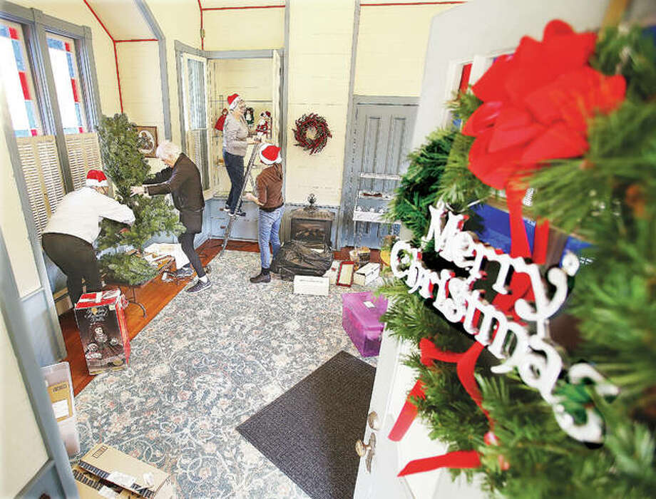 From the left, Lucy Playhouse Association members Debbie Schuneman, Margaret Hopkins, Chris Alford and Debbie Rowden start decorating Monday for the annual Victorian Christmas at the Lucy Haskell Playhouse, 1211 Henry St. in Alton. The Dec. 1 event features Santa and Mrs. Claus on hand to greet children in the historic playhouse from noon until 2 p.m. Photo: John Badman | The Telegraph