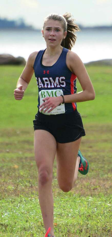 GFA cross country runner Caroline McCall, a resident of Westport, sprints to the finish of last weeks FAA championship meet, placing third and leading the Dragons to a third-place finish, one point out of second place. Photo: Greens Farms Academy Athletics / Contributed Photo