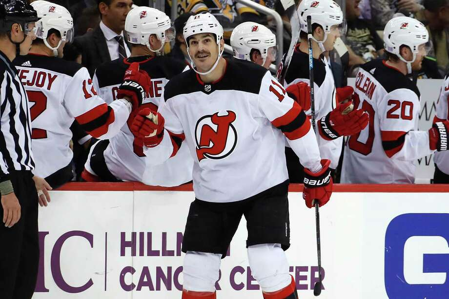 90b7f9f7dc2a44 New Jersey Devils' Brian Boyle (11) returns to the bench after getting his