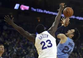 Memphis Grizzlies' Dillon Brooks, right, shoots against Golden State Warriors' Draymond Green (23) during the first half of an NBA basketball game Monday, Nov. 5, 2018, in Oakland, Calif. (AP Photo/Ben Margot)