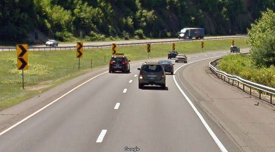Here is an example of curve signs that warn drivers of a sharp curve on southbound Route 8 in Beacon Falls. In an effort to reduce fatal and serious injury crashes on curves, the Department of Transportation is proposing to install warning signs on state roads in southwest Connecticut. Photo: Google Street View