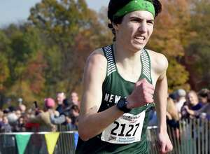 Eli Nahom, of New Milford, finishes first in the CIAC Boys Cross Country State Open Championship at Wickham Park in Manchester with a time of 15:54 on Nov. 1.