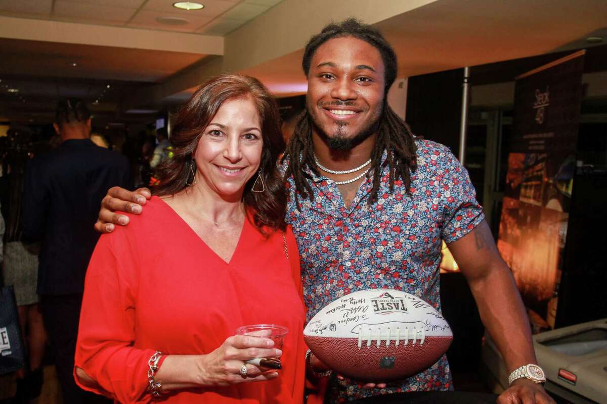Dawn Koerner and Houston Texan D'Onta Foreman at Taste Of The Texans.