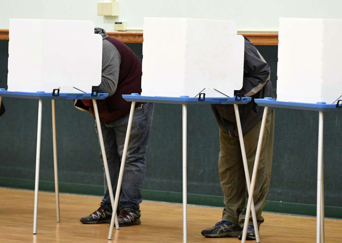 Voters take to the polls at Bethlehem Town Hall to vote in midterm elections on Tuesday, Nov. 6, 2018, in Delmar, N.Y. (Will Waldron/Times Union)