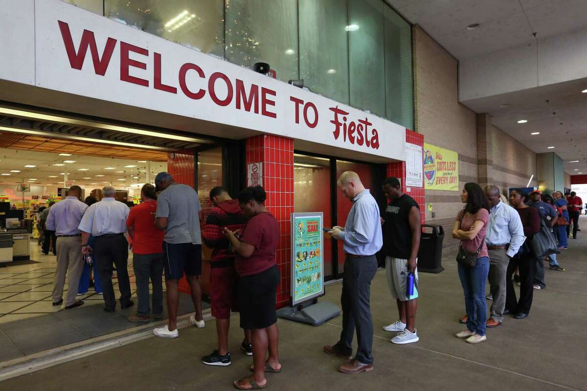 Voters line up outside of Fiesta Mart on Kirby Drive and Old Spanish Trail and wait to vote on Tuesday, Nov. 6, 2018, in Houston.