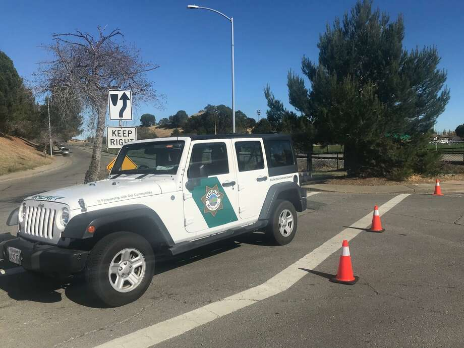 Marin County sheriff's officials block off streets near Helen Vine Detox Center, where three people were shot, one fatally, in the early morning hours of Monday. Photo: Megan Cassidy / The Chronicle