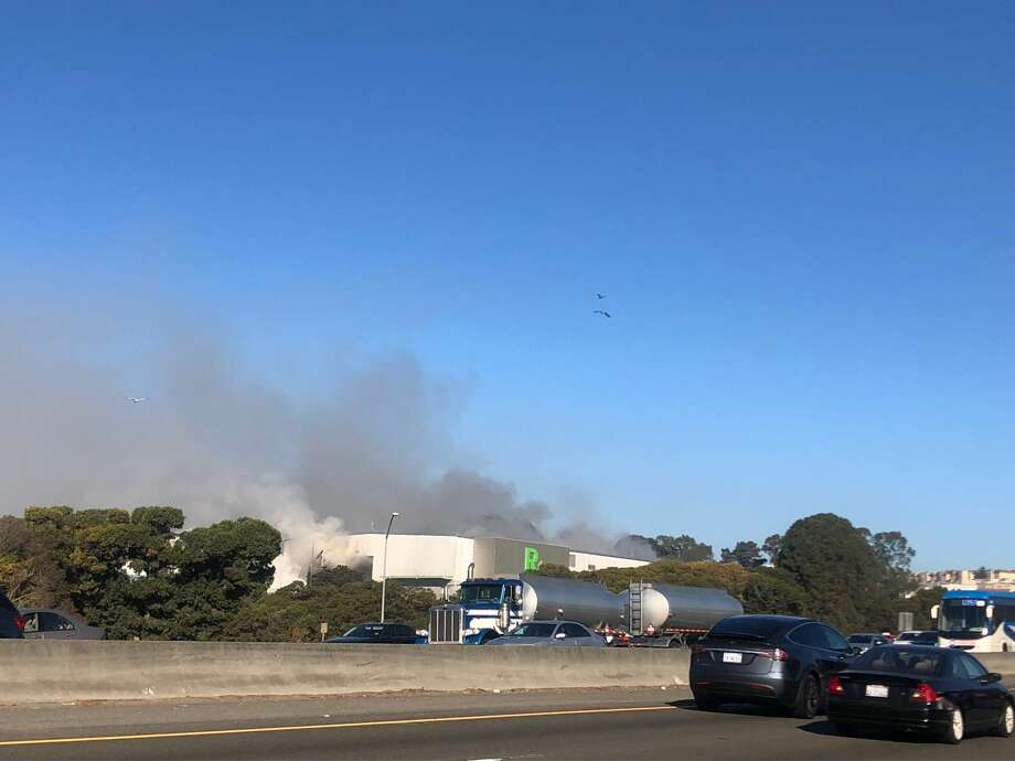 A view from Highway 101 of the smoke billowing up from the Recology San Francisco transfer station near the Brisbane border. Photo: Susy Guerrero / SFGate
