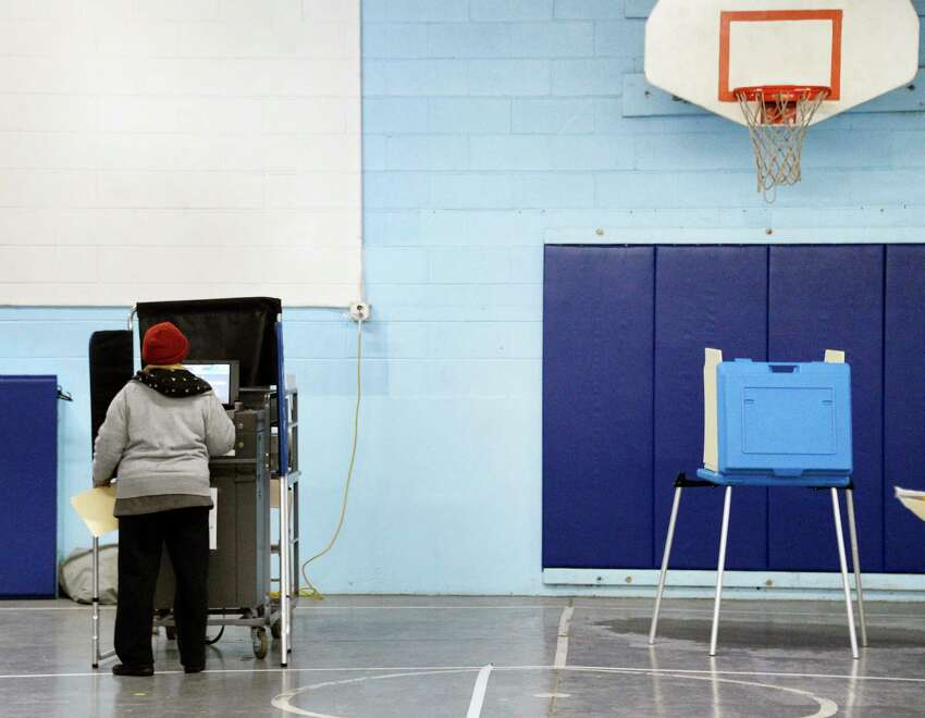 A voter casts her ballot at the Parks & Recreation Department Tuesday Nov. 6, 2018 in Albany, NY. (John Carl D'Annibale/Times Union)