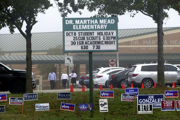 Voters and arrive and leave Dr. Martha Mead Elementary School, a polling place near Medical Center, on Tuesday, Nov. 6, 2018.