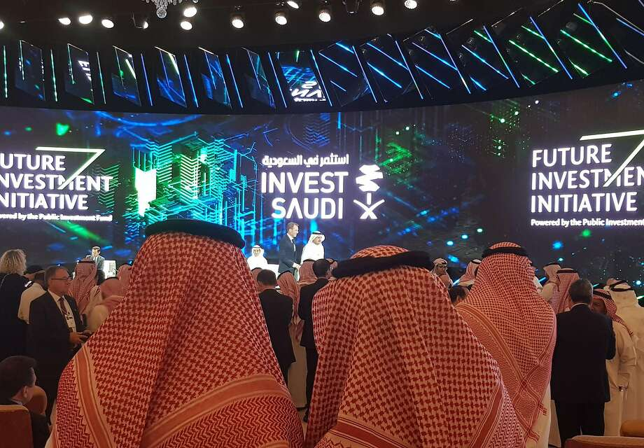 "An ""Invest Saudi"" ad is the backdrop for the Oct. 23 opening day of the Future Investment Initiative conference in Riyadh. Photo: Javier Blas / Bloomberg"
