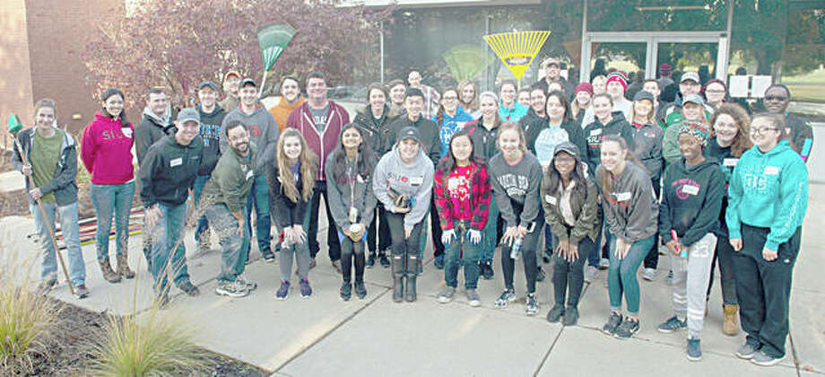 SIUE School of Pharmacy students and the Pre-Pharmacy Association gathered before spreading throughout the community to clean up the yards of senior citizens. Photo: For The Telegraph